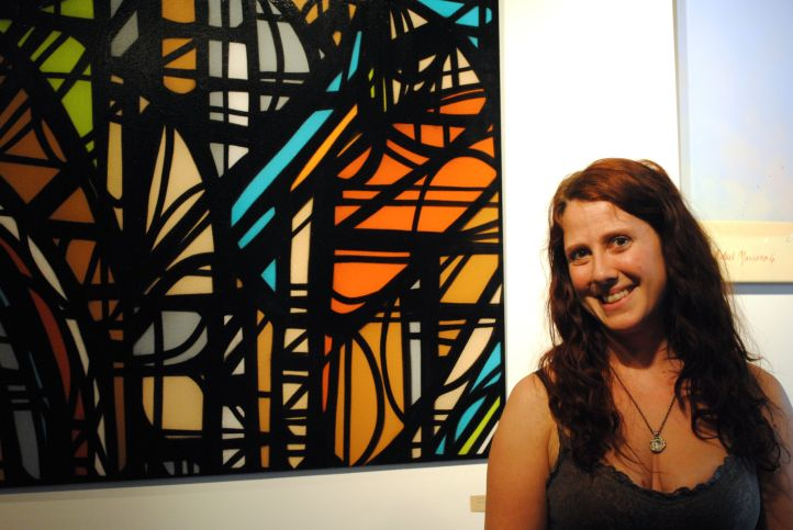 Dayna Reed of greenHAUS shows off a JB Snyder work.