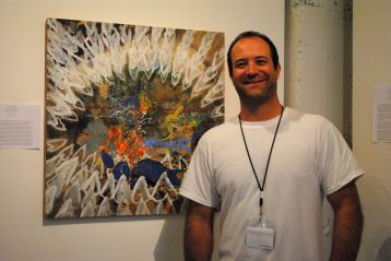 Justin Germain of monOrchid stands with a Sue Chenoweth piece.