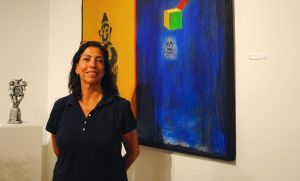 The interview with Annie Lopez partially took place at R. Pela Contemporary Art. Here, she stands in front of a work by her husband, Jeff Falk.