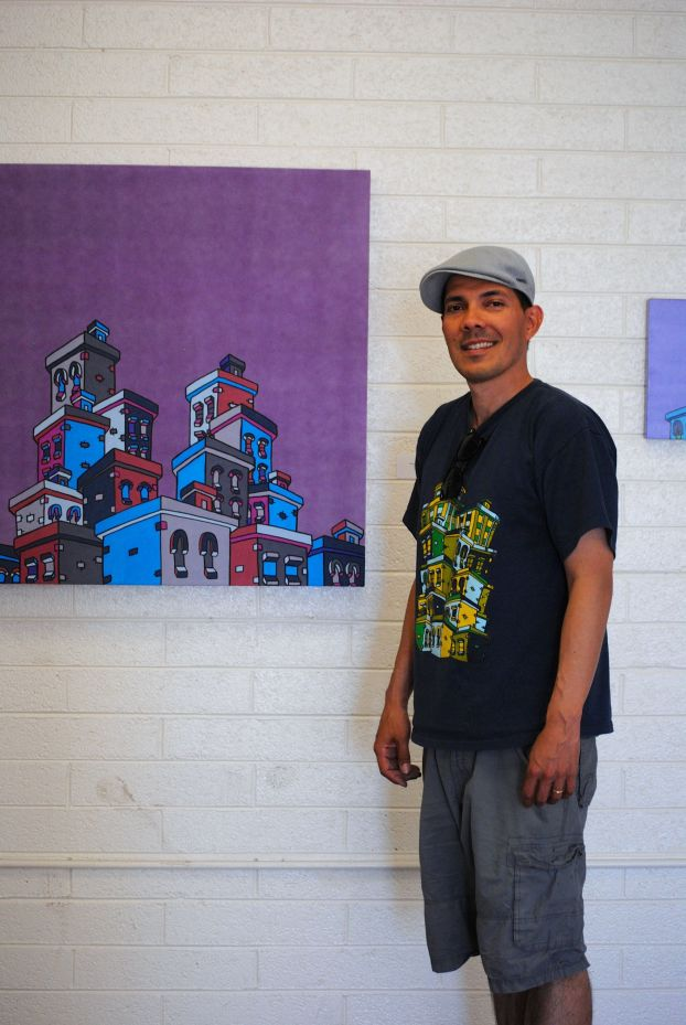 Local artist Ishmael Dueñas was one of several artists greeting the crowds on Grand Avenue.