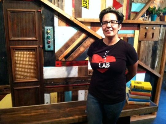 Monica Robles with her wall art made from salvaged materials.