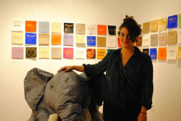 "At Modified Arts, Sarah Hurwitz poses with a prop most appropriate for her show, ""An Elephant Never Forgets,"" for which she's mounted dozens of placards with sayings like, ""An elephant never forgets to pack clean underpants"" and ""... never forgets which is a stalagmite and which one is a stalactite."" Witty stuff."