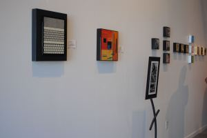 Plaques by Sarah Kriehn shared wall space with miniatures by Denise Yaghmourian at YAG Art Space on Grand Avenue.