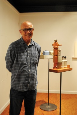 "Remarkably, Larry Kornegay spent 35 years playing with the tall carving in ""Gary, Booger and the Kids"" (foreground) before he felt he had it right. See his work at Modified Arts."